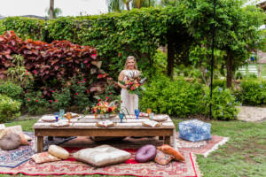 garden_boho_bride_smiling_pillows_short_table_florals